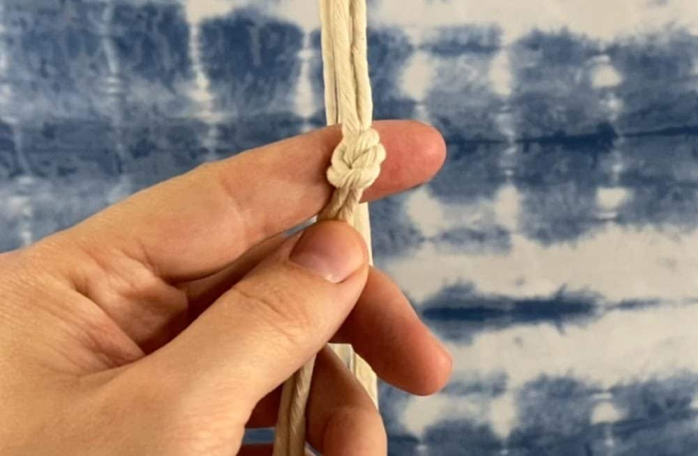 tie the first row of overhand knots